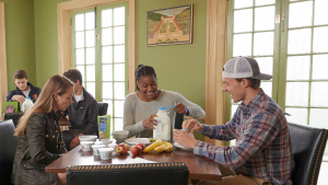 Young adults eating breakfast