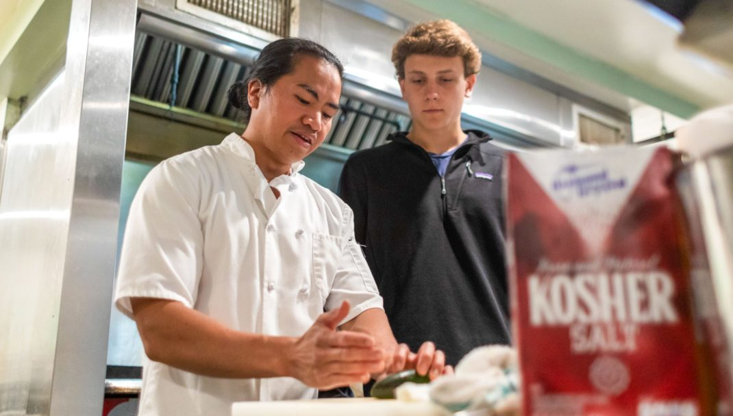 Chef Pete with a student cooking