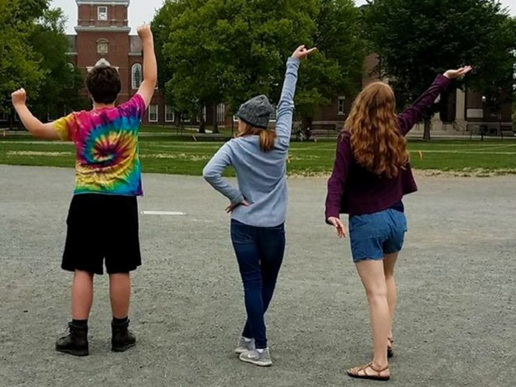 Three students exploring a small town for exposure therapy