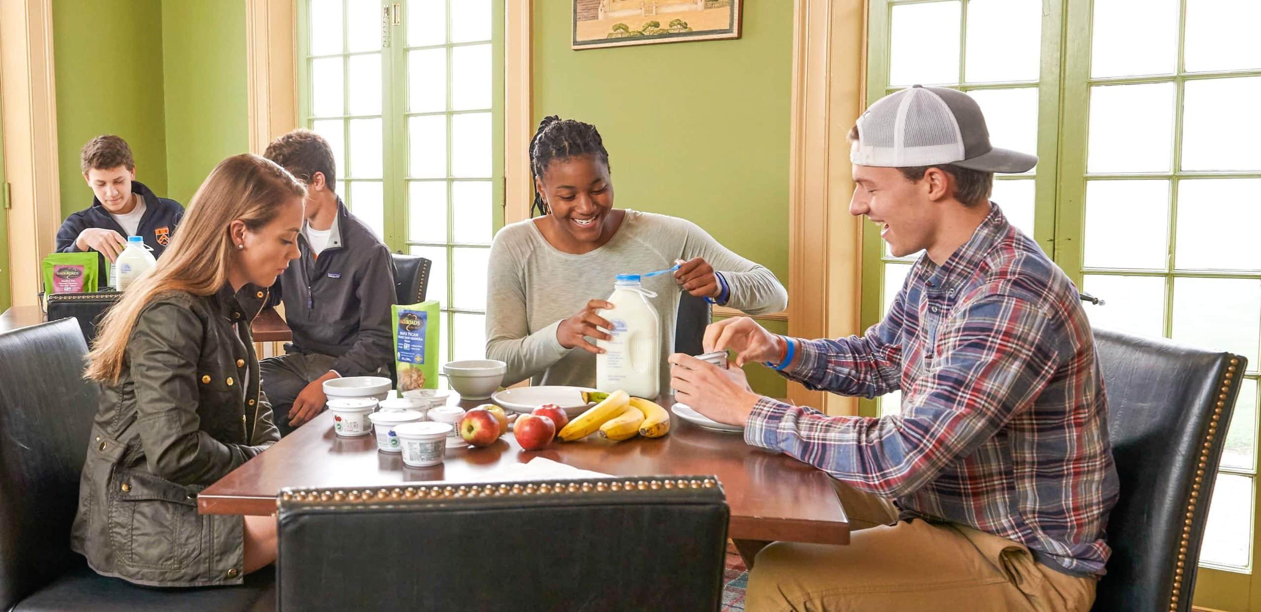 Three students eating breakfast