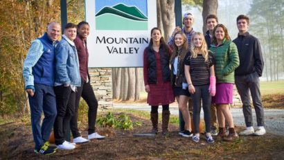MVTC staff and students standing by the entrance sign